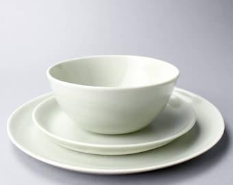 "celadon place setting, 10"" plate, 7.5"" plate, 6"" bowl"