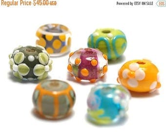ON SALE 30% off Handmade Glass Lampwork Bead Set - Seven Colorful Rondelle Beads 11001001