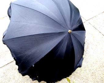 Victorian style vintage 30s black acetate umbrella- parasol with a short hadle and scalloped, ruffled edges.