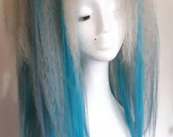 Pair of mixed blues and blonde long hair falls on strong elastic.