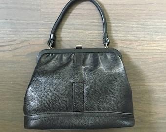 1950s black pebbled leather kelly bag frame bag doctor's bag with printed lining