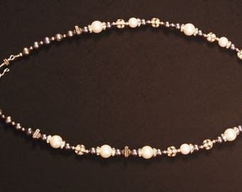 Glass pearls, rhinestones, and silver