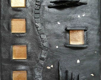 Mosaic slate black and gold, a window at night