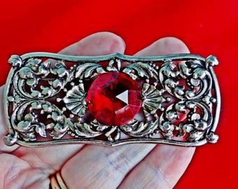 "Vintage  2.75"" silver tone modernist brooch with  red lucite rhinestone accent in great condition"