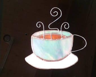 Blue Mug of Coffee Suncatcher in stained glass with wonky white saucer and polished wire handle and swirly steam