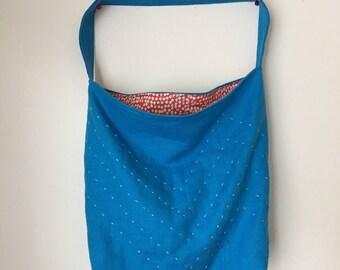 upcycled embroidered blue and orange shoulder bag