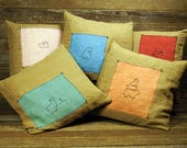 linen plant dyed patch pillows:  by kata golda