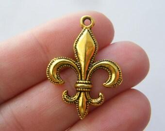 8 Fleur de lis charms antique gold tone GC334