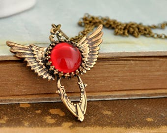 THE VICTORIAN DAGGER antiqued brass winged dagger necklace with ruby red Swarovski glass jewel