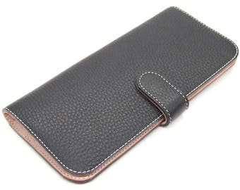 Navy leather clutch purse with pink inner, 12 card slots and large zip pocket