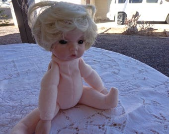 Handmade Porcelain Doll Baby - Moveable limbs and pretty blonde hair  Not dressed.  Like new condition