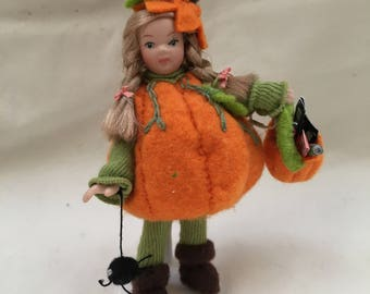 Dolls House Miniatures - 1/12th Pumpkin dressed girl doll