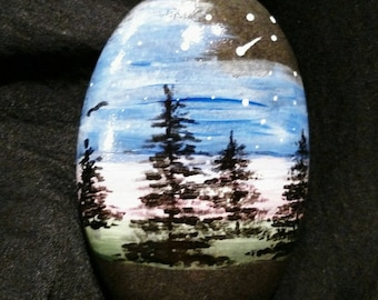 A serene night sky painted with acrylics on a beach pebble.  Free Shipping.