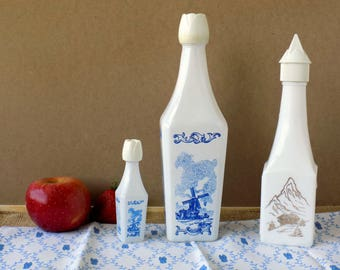 Liquor Bottles. Whiskey Decanters. Delft Windmill. Swiss Alps and Swiss Chalet. Blue and White Decor. Kitchen Display. Vintage Housewares.