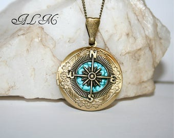 With a blue background (p) compass photo pendant