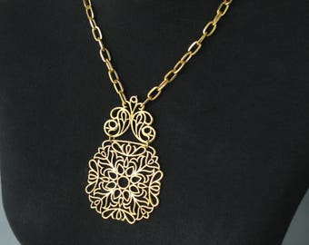 Vintage 70s CROWN TRIFARI Gold Tone Open Work Flower Floral Design Hinged Medallion Matinee Length Statement Necklace