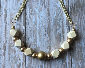 Gold and natural beaded wood necklace