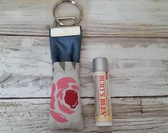 Rosey Posey chapstick cozy. Ju-Ju-Be customs. Lip products
