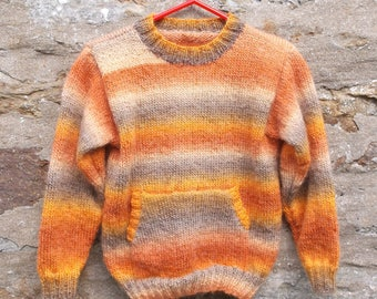 "Unisex. Hand knitted boy or girl's self patterning  pullover sweater with kangaroo pocket 26"" chest Orange shades"