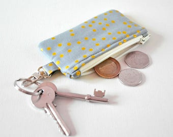 Women's metallic gold spot change pouch key chain fob coin padded gadget purse in gold and grey print.