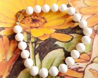 Classic Vintage Monet white bead bracelet gold tone