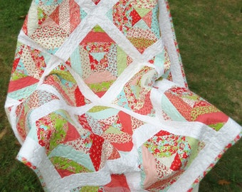 """Girl's Modern Block Patchwork Lap Quilt made from """"Little Ruby"""" fabric line."""