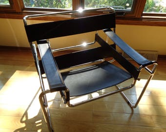 Retro Wassily Chair designed by Marcel Breuer in Vintage Condition with original Silver Chrome Metal Design and Black Cowhide Leather Straps