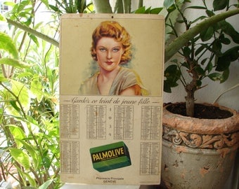 1934 French soap calender publication, printed cardboard shop sign, Palmolive soap,pin up girl.