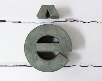 French Vintage Shop Sign...Metal Sign...'e' with a grave....Chippy Sage Green Paint.