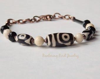 Tibetan Dzi Agate and Cream Riverstone Bracelet, Geometric Black and White Stone, Copper, and Glass Beads, Modern Bohemian Tribal Jewelry
