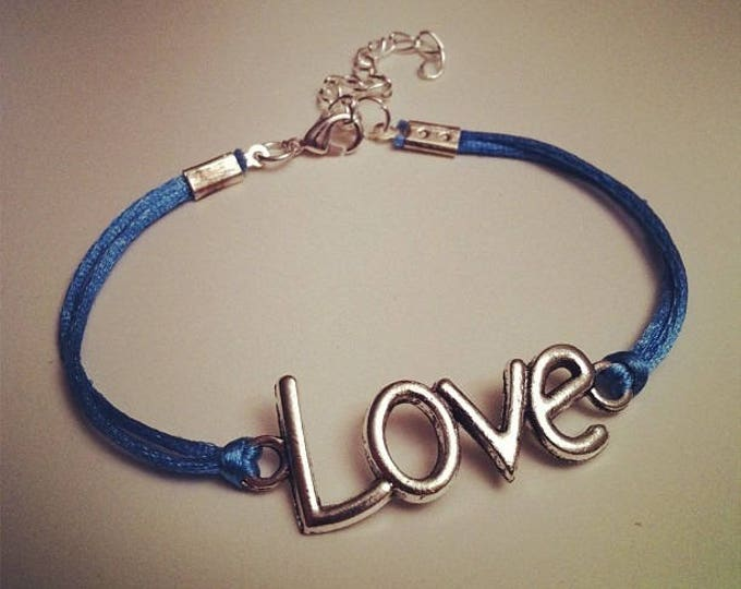 Light blue cord bracelet with LOVE silver