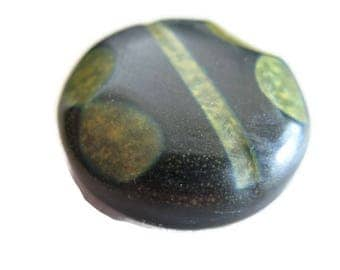 vintage dark green button with unique mottled green shapes