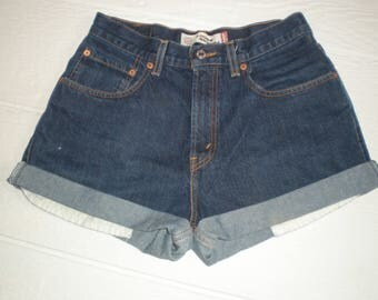 Levis denim, high waisted cut off shorts. Dark blue denim shorts, 28 30 inch waist. Cut offs.