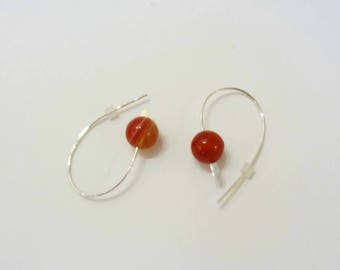 Silver earrings and orange-red carnelian bead