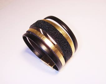 Black Gold Leather cuff and black caviar with clasp gold