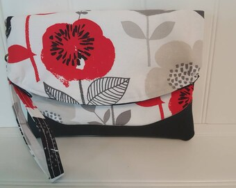 Fold over clutch wristlet in bold floral with vinyl accent