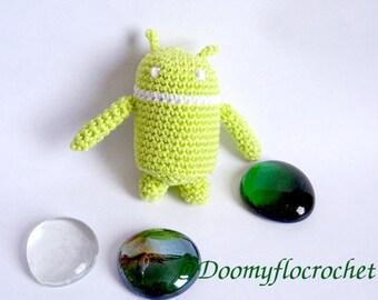 Green amigurumi crocheted Bugdroid figurineAndroid phone