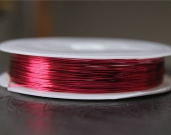 a spool of 0.4 mm Fuchsia colored copper wire 13 M