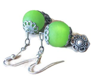 Green beads and silver filigree flower earrings