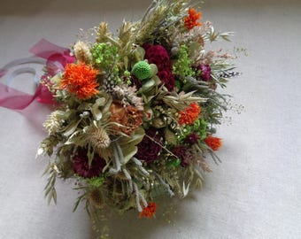 Rustic autumn country woodland bridal wedding bouquet with orange green and burgundy dried flower wedding bouquet