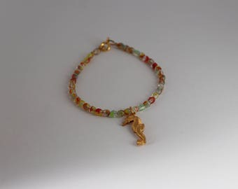 Czech glass beach colored bracelet hand strung in 7 1/4 inch length with sea horse charm