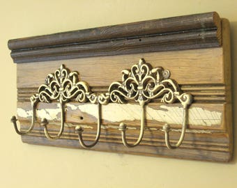 Shabby chic wall-hung five-hook rack on salvaged antique base board