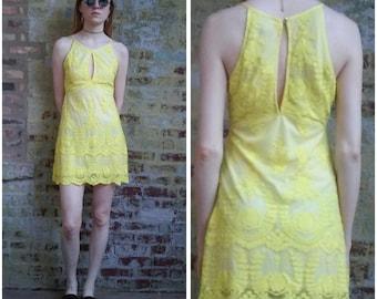 Sheer mesh embroidered peekaboo mini dress