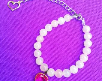 Charmed rose quartz bracelet