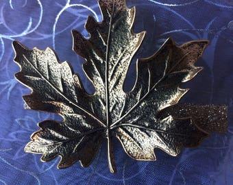 Gold colored fall maple leaf alligator clip.