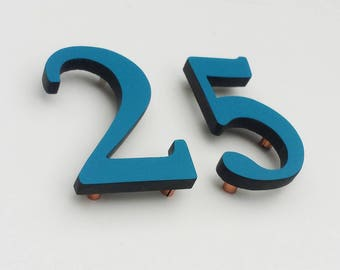 "Modern architectural Coloured House numbers,  9""/228mm high in Garamond font,  standoff floating in resin board g"