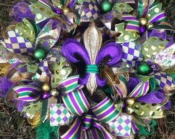 Sale 25x28 Mardi Gras Wreath regular 65.00 now 59.99 Fleur de Lis Wreath available in Two Styles