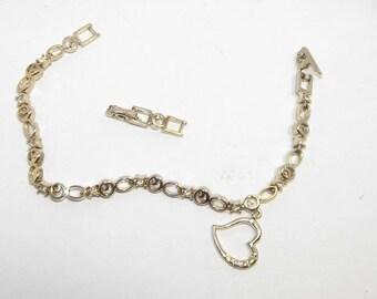 Vintage gold Avon Crystal / Rhinestone Tennis Bracelet, w/extension & heart.  #304