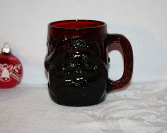 Red glass Santa mug by Arcoroc in like new condition, design all the way around the cup