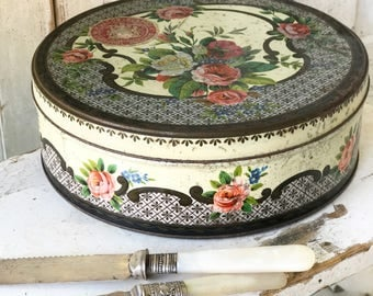 A vintage WR Jacob & Co. pretty floral cake or biscuit tin